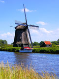 Dutch countryside. Traditional Dutch windmill along a canal near Alkmaar, Netherlands Royalty Free Stock Photo