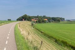 Dutch countryside with inland dike and meadows Stock Photo