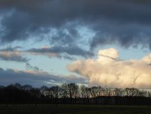 Countryside sunset with clouds. royalty free stock images