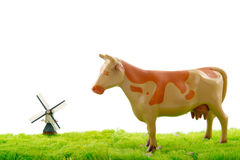 Dutch cow and windmill Stock Image