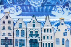 Dutch Delft blue souvenir houses in front of an old plate Royalty Free Stock Image