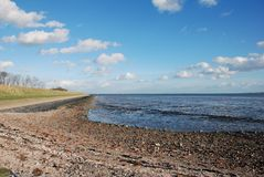 Dutch dike ebb low tide Stock Photography