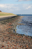 Dutch dike ebb low tide Stock Photo