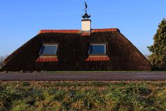 Dutch dike house with straw roof Stock Photos