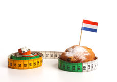 Dutch donuts called Oliebollen with measuring tape Royalty Free Stock Image