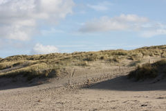 Dutch dunes with cloaded sky. A photo of the dunes in the Netherlands royalty free stock images