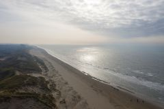 Dutch dunes by the sea from above royalty free stock photo