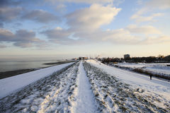 Dutch dyke in the snow Stock Images