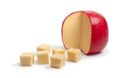 Dutch Edam cheese with cubes. On white background royalty free stock photo