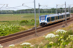 Dutch electric train in the countryside Royalty Free Stock Photo