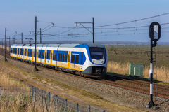 Dutch electric train traveling through the countryside Royalty Free Stock Images