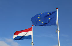 Dutch and European Union Flag Stock Image