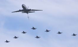 Dutch F-16 squadron in formation with a KDC-10 Royalty Free Stock Photo