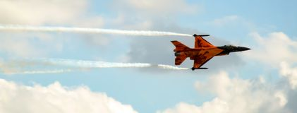 Dutch F-16 Fighting Falcon in special orange livery. royalty free stock image