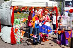 Leeuwarden, Netherlands, May 5 2018, Dutch family national costumes celebrations. Dutch family is dressed up in the colors of the Dutch flag and stands between Stock Images