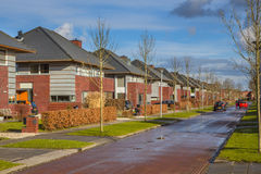 Dutch family houses in a suburban street Stock Photography