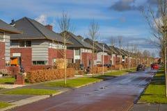 Dutch family houses in a suburban street Stock Photography