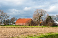 Dutch farm in a colorful autumnal landscape Stock Image