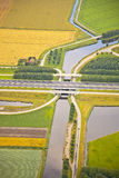 Dutch farm landscape with infrastructure. Road and canal Royalty Free Stock Photo