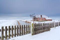 Dutch farmhouse in white snow Royalty Free Stock Photos