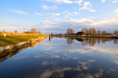 Dutch farmhouse by wide river Stock Images