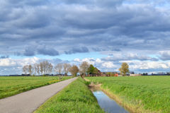 Dutch farmland with clouded sky Royalty Free Stock Images