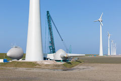 Dutch farmland with construction site ner wind turbines stock photo