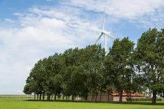 Dutch farmland with farmhouse and windturbine Royalty Free Stock Images