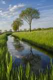 Dutch farmland. Typical Water way in Dutch Farmland Royalty Free Stock Photography