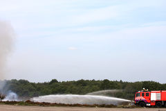 Dutch fire brigade in action. The dutch fire brigade is extinguishing a heath fire with big jets of water Stock Photography