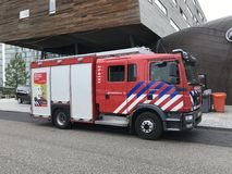 Dutch fire department truck. Almere, Netherlands - May 26, 2018: Dutch fire engine or truck standing in font by the side of the road. Nobody in de vehicle royalty free stock photo