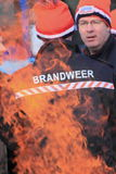 Dutch fire fighter department. Member of the dutch fire fighter department during the traditional new-years dive in the water of Bussloo, the Netherlands. The stock photos