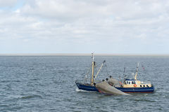 Dutch fishing boat at wadden sea Royalty Free Stock Image