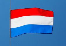 Dutch flag against the blue sky Stock Photo