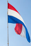 Dutch flag against the sky Royalty Free Stock Photo