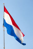 Dutch flag against the sky Stock Image