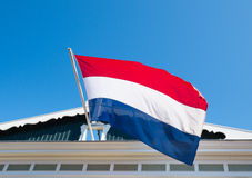 Dutch flag. Blowing in the wind on the facade of a house Royalty Free Stock Photo