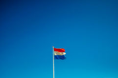 Dutch flag broken. With a blue sky Royalty Free Stock Photography
