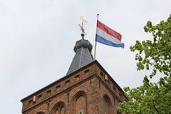 Dutch flag on a church tower Stock Photos