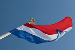 Dutch flag with a crown on top of the flagpole Royalty Free Stock Photography