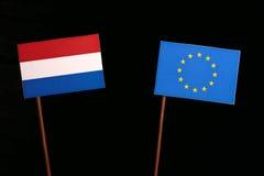 Dutch flag with European Union EU flag  on black. Background Stock Image