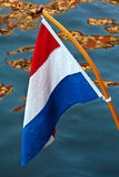 Dutch flag hanging above a canal Royalty Free Stock Images