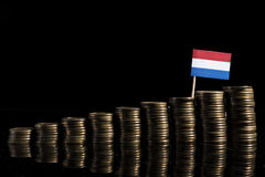 Dutch flag with lot of coins isolated on black. Background Royalty Free Stock Photo
