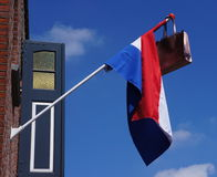 Dutch flag with a satchel. An official Dutch flag with a satchel attached, a tradition when a student graduates Stock Image