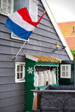 Dutch flag waving on a typical house Royalty Free Stock Photos