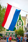 Dutch flag waving in Zaandam, land of windmills Stock Photography