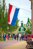 Dutch flag waving in Zaandam, land of windmills Stock Photos