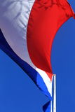 Dutch flag. In the wind with bleu sky Stock Image