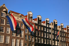 Dutch flags on canal houses. Royalty Free Stock Photos