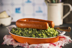 Dutch food: kale with smoked sausage or 'Boerenkool met worst' Royalty Free Stock Photos